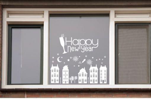 Raamsticker - Huisjes vuurwerk/ Happy new year - Voor oud en nieuw maak je, je decoratie helemaal af met dit leuke straatje voor op de ramen